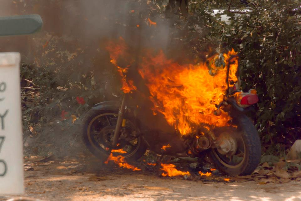 I saw a burning motorcycle on my first week in Belize. It was an omen of the year to come. My first year on the road.
